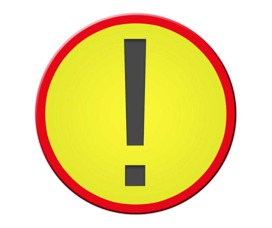 Okragły znak z ostrzegawczy z wykrzyknikiem. Czarny wykrzyknik na żółtym tle z czerwoną obramówką