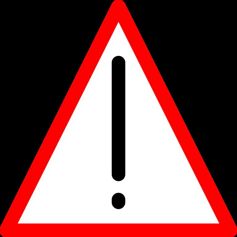 Na zdjęciu czerwony trójkąt z białym tłem w środku i czarnym wykrzyknikiem